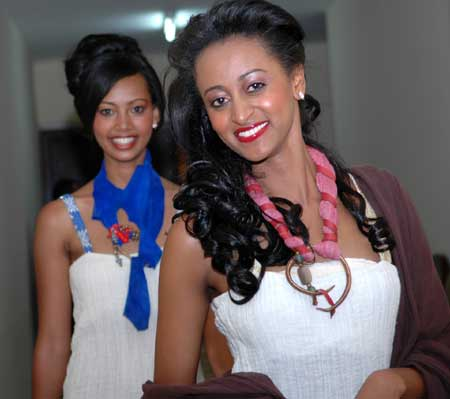 Two girls pose for a photo at the tiring-room during the finals of the Miss Ethiopia 2009 Beauty Pageant in Addis Ababa, capital of Ethiopia, Jan. 18, 2009.
