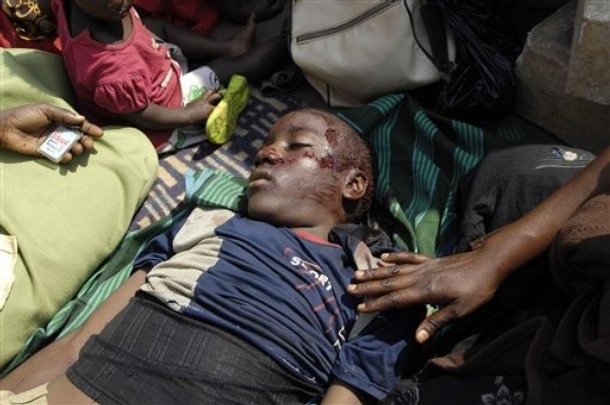 A 13-year old boy lies dead after he got shot in the head during riots in Kampala