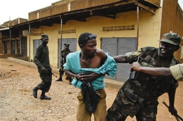 Uganda military police arrest a man during riots in Kampala, Uganda