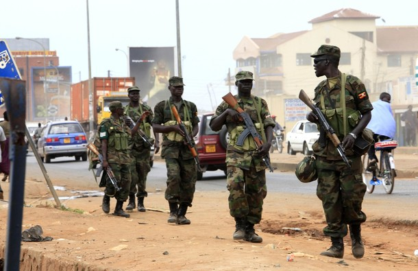 Ugandan military personnel patrol the streets in the Natete neighbourhood of the capital Kampala