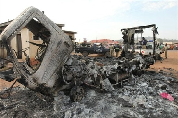 A Police vehicle is burnt  out, along with other vehicles around the area near to the razed Nateete Police Station in Kampala, Uganda