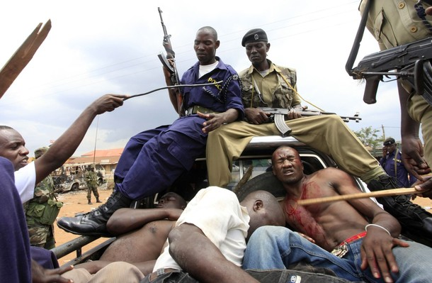 Ugandan police arrest suspected looters and rioters in the Natete neighbourhood of the capital Kampala