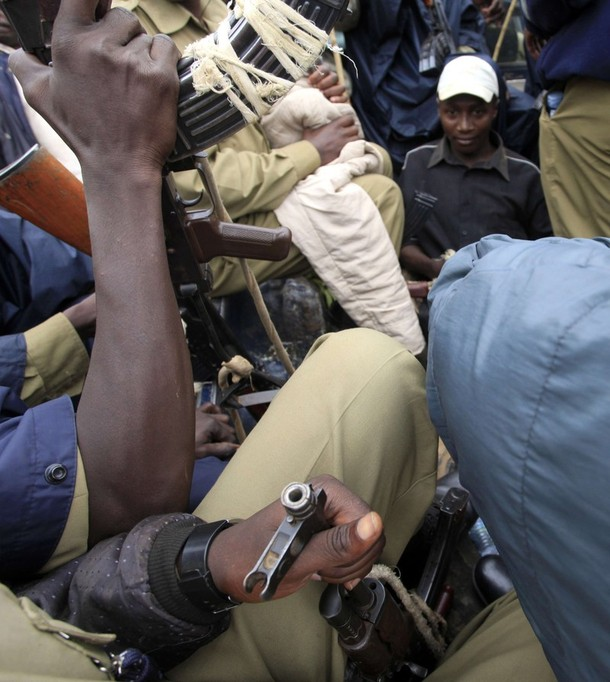Police arrest a suspected rioter after clashes over a row between the Ugandan government and Buganda in Kampala