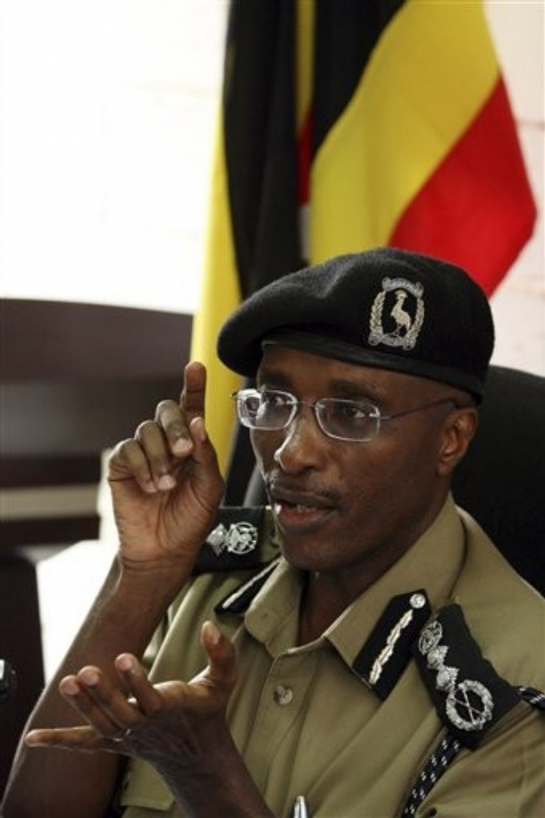 The Ugandan Commissioner for Police Maj. Gen. Kale Kayihura  gestures as he speaks during a press conference in Kampala, Uganda