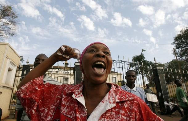 woman chants slogans outside the Buganda Parliament in Uganda's capital Kampala