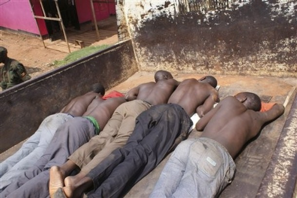 Some of the rioters are made to lie on their stomach after they were arrested in Uganda' Capital Kampala
