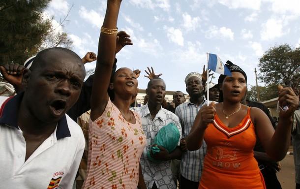 Royalists chant slogans outside Buganda Parliament