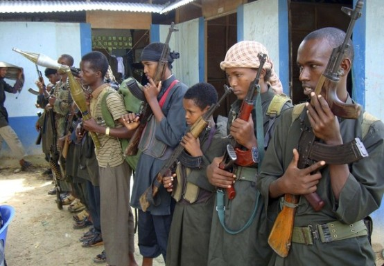Armed fighters from the militant group Hizbul Islam line up after finishing months of training at an undisclosed location in Mogadishu