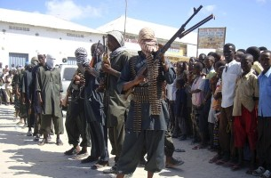 Hardline Somali Islamist insurgents from Hisbul Islam parade with their weapons in the streets of Somalia's capital Mogadishu