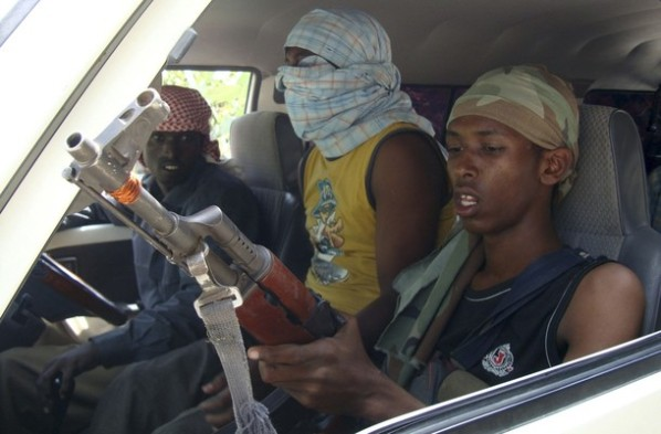Islamist militants ride on minibus in south Mogadishu Wardiglay neighborhood of Somalia's capital Mogadishu