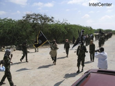 Handout shows members of Somalia's al Shabaab, whom IntelCenter described as marching with weapons during graduation ceremony in Mogadishu
