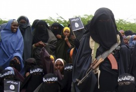 A female Al Shabaab fighter holds her gun during a demonstration against the AMISOM in Suqaholaha neighborhood, north of Mogadishu