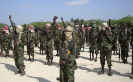 Members of the hardline al Shabaab Islamist rebel group cheer during a parade in Somalia's capital Mogadishu