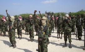 Members of the hardline al Shabaab Islamist rebel group cheer during a parade in Somalia's capital Mogadishu