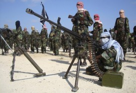 Members of the hardline al Shabaab Islamist rebel group parade their weapons in Somalia's capital Mogadishu