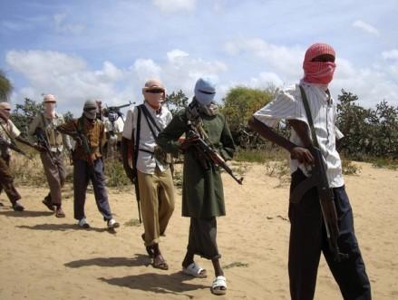Gunmen from Hizbul Islam patrol Afgoye as they wait to head to Somalia's southern port of Kismayu