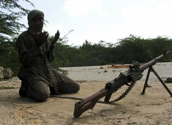 A hard-line Somali Islamist prays near a roadblock in southern Mogadishu