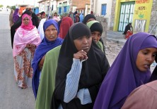 Women wait in line on June 26, 2010 outs