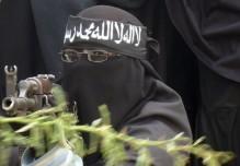 A female Al Shabaab fighter points a gun during a demonstration against AMISOM in Suqaholaha neighborhood, north of Mogadishu