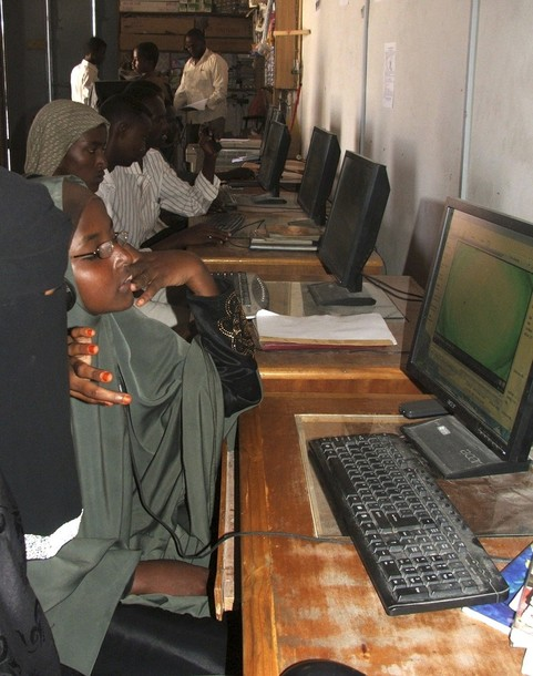People surf the Internet at a cyber cafe in Elasha Biyaha neighbourhood on the outskirts of Mogadishu