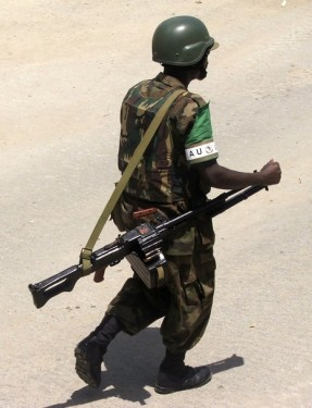 A Ugandan peacekeeper from the AMISOM patrols outside the presidential palace in Somalia's capital Mogadishu