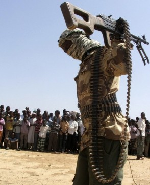An armed militant from Somalia's Hizbul Islam rebel group maintains order during a demonstration on the outskirts of Mogadishu
