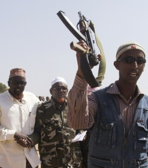 Leader of insurgent group Sheikh Aweys arrives for a demonstration against the presence of the AU peacekeepers on the outskirts of Mogadishu