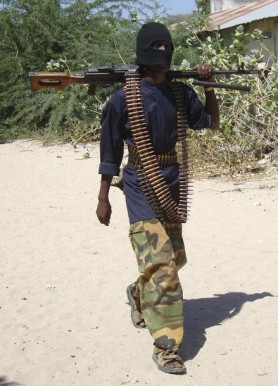 An armed militant from Somalia's Hizbul Islam rebel patrols in southern Mogadishu