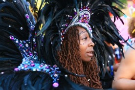 A dancer wearing a big headdress at the Notting Hill Carnival. London, UK, 30/08/2010 -- Dancers paraded through the streets of Notting Hill in West London during the annual multicultural street festival. London, UK. 30/08/2010