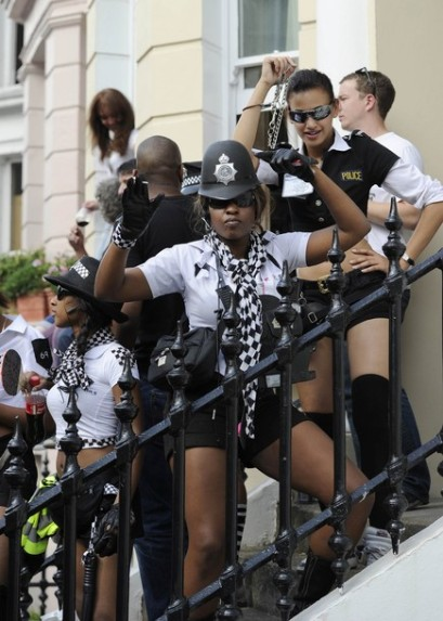 Women dressed as British policewomen, take part at the annual Notting Hill Carnival street party in London