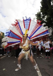 A woman takes part in the annual Notting Hill Carnival street party in London